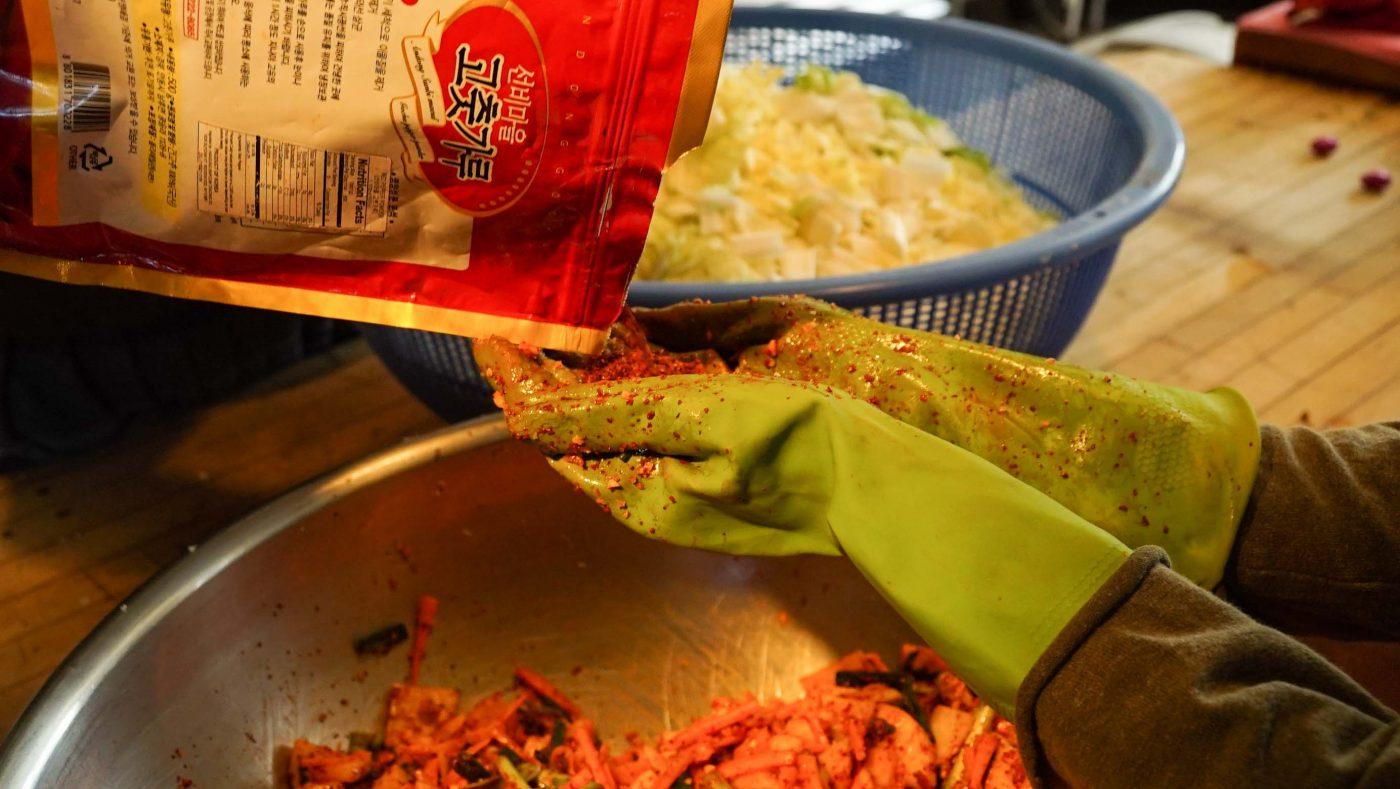 Adding the secret ingredient (Korean chili mix).