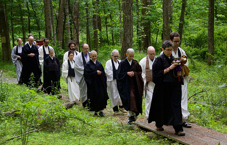 procession walks thru woods