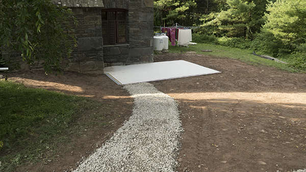 One of the first steps was putting in a cement foundation where the walk in cooler will live. The path is a walkway for deliveries. (July 23)